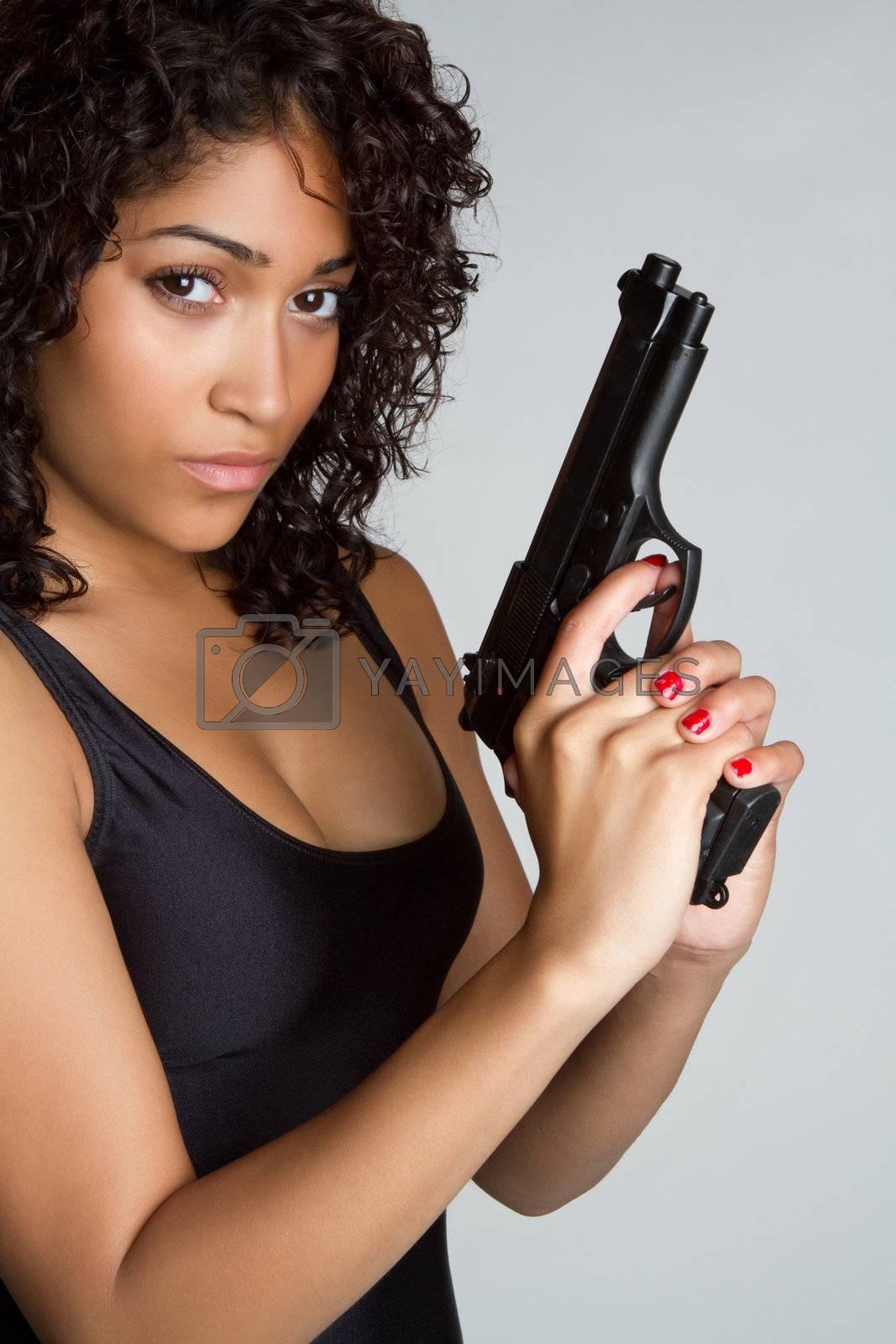 Beautiful black woman holding gun