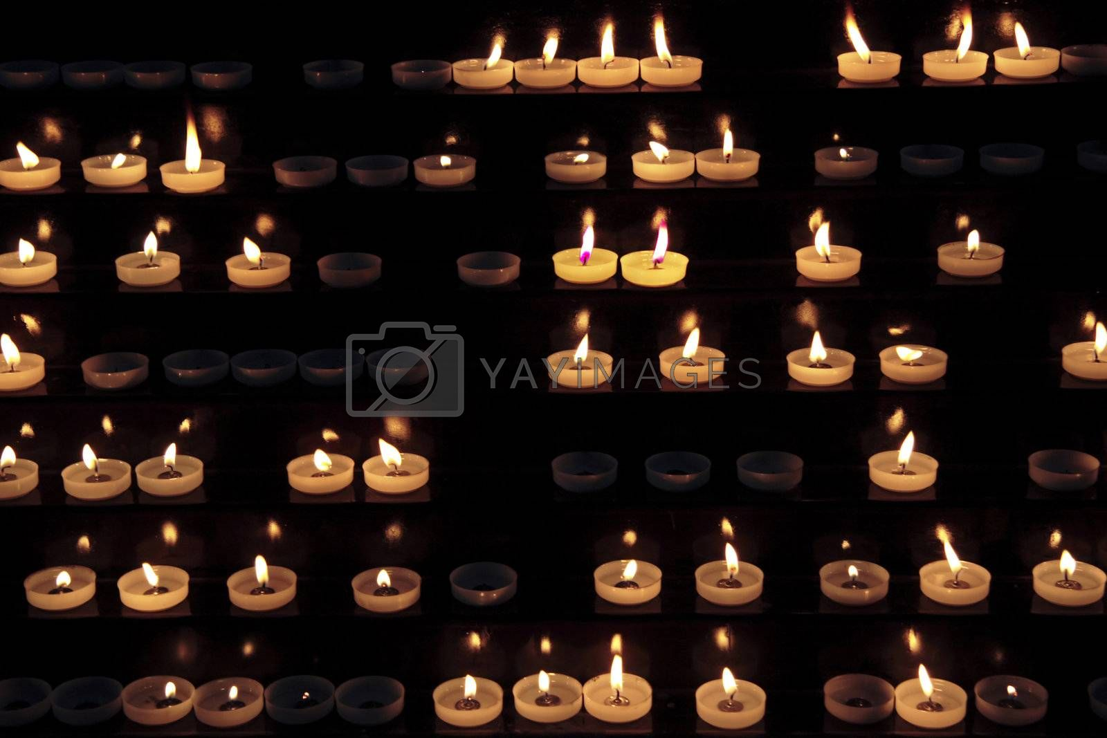 candles alight within a church