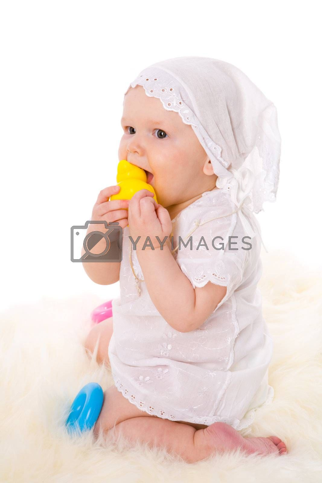 Baby girl in age one year playing with toys isolated on white