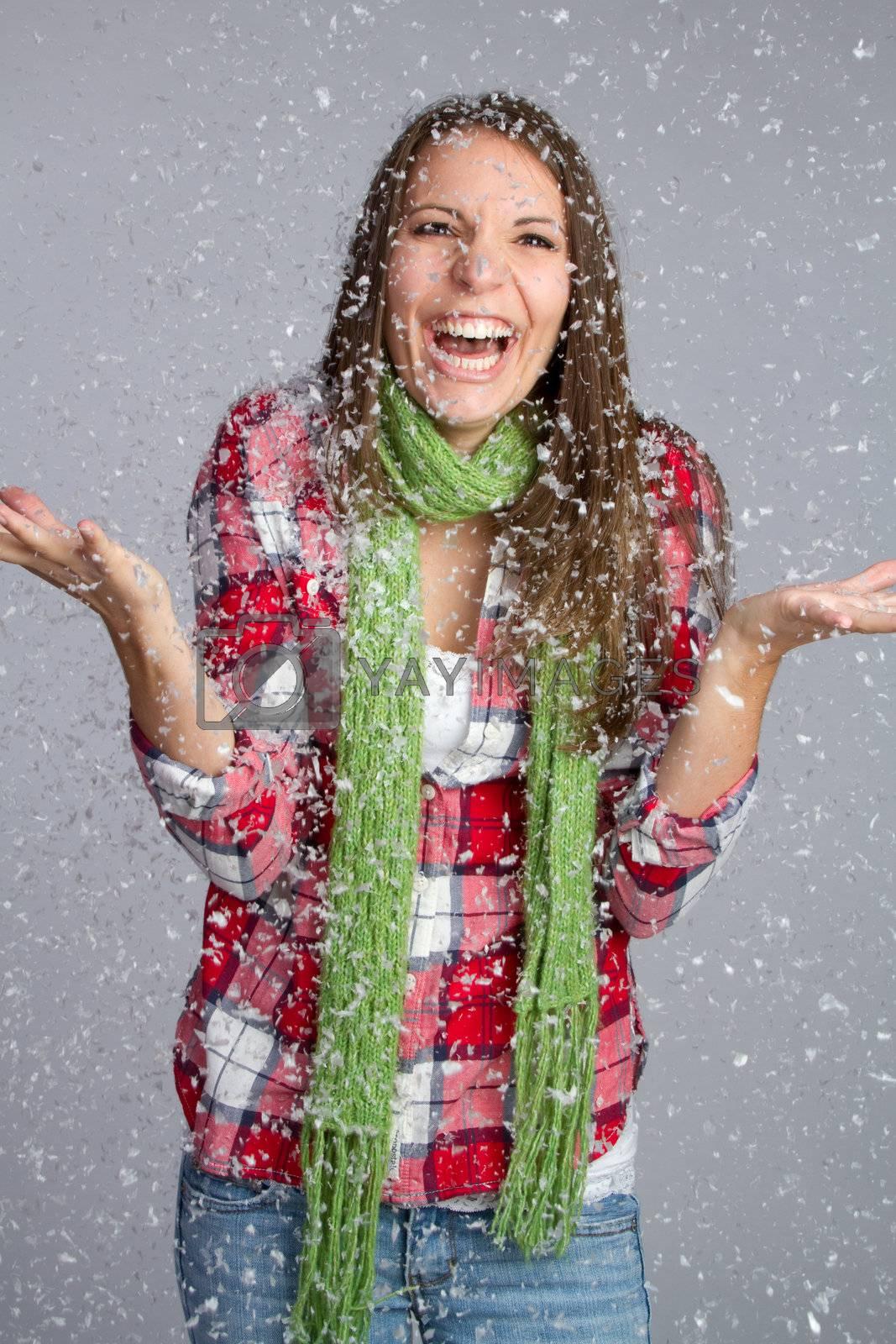 Beautiful girl playing in snow