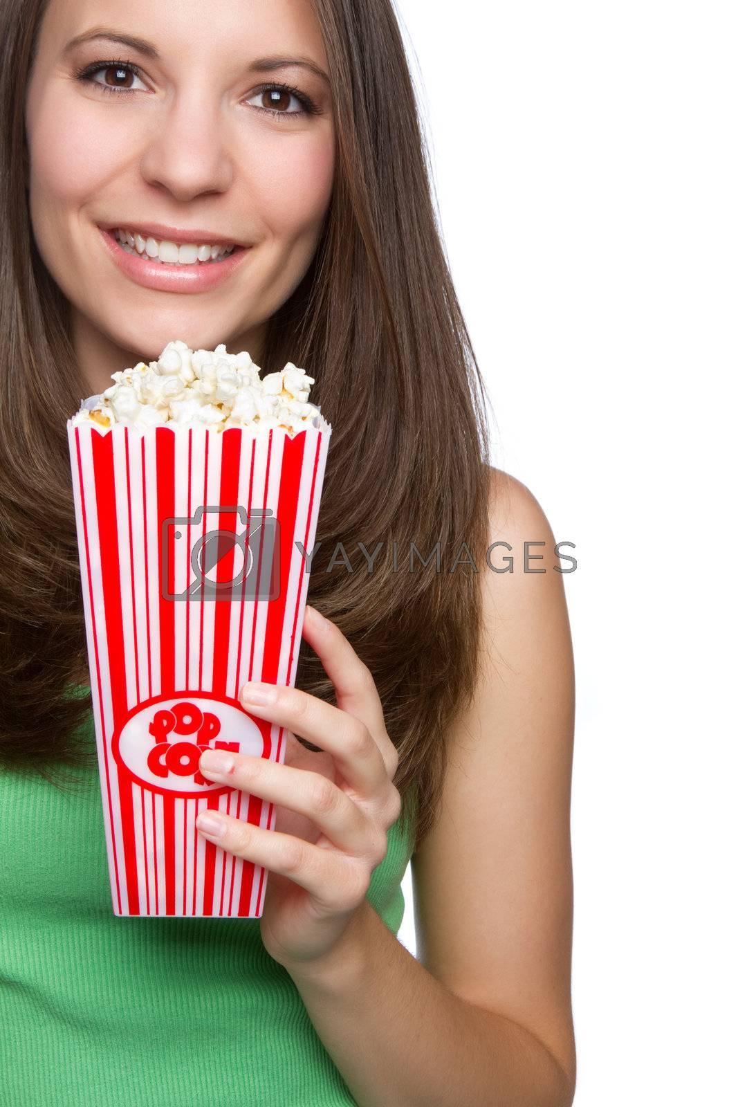 Beautiful teen girl eating popcorn