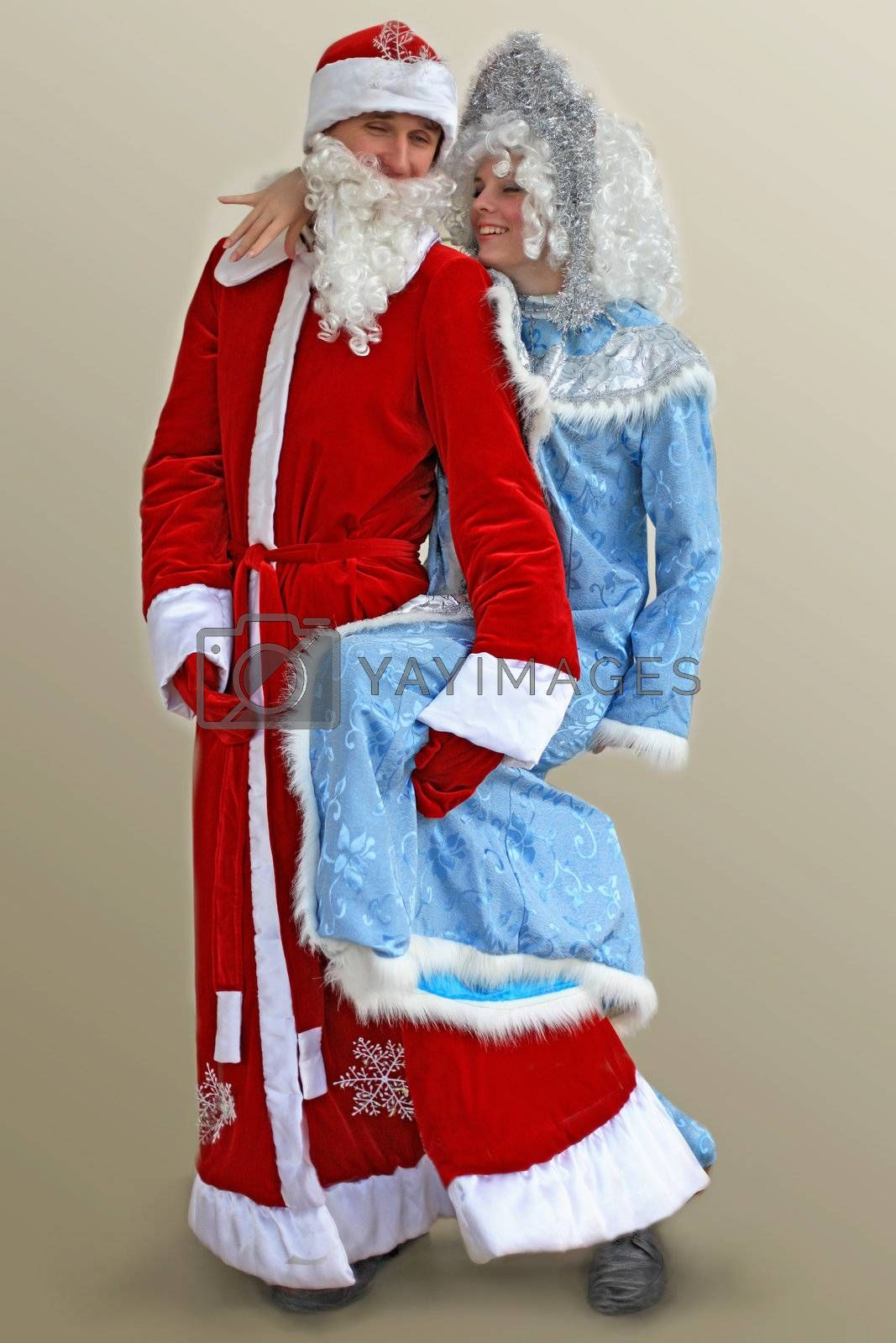 Santa Claus and Snow Maiden are having fun on holiday, greeting the New Year