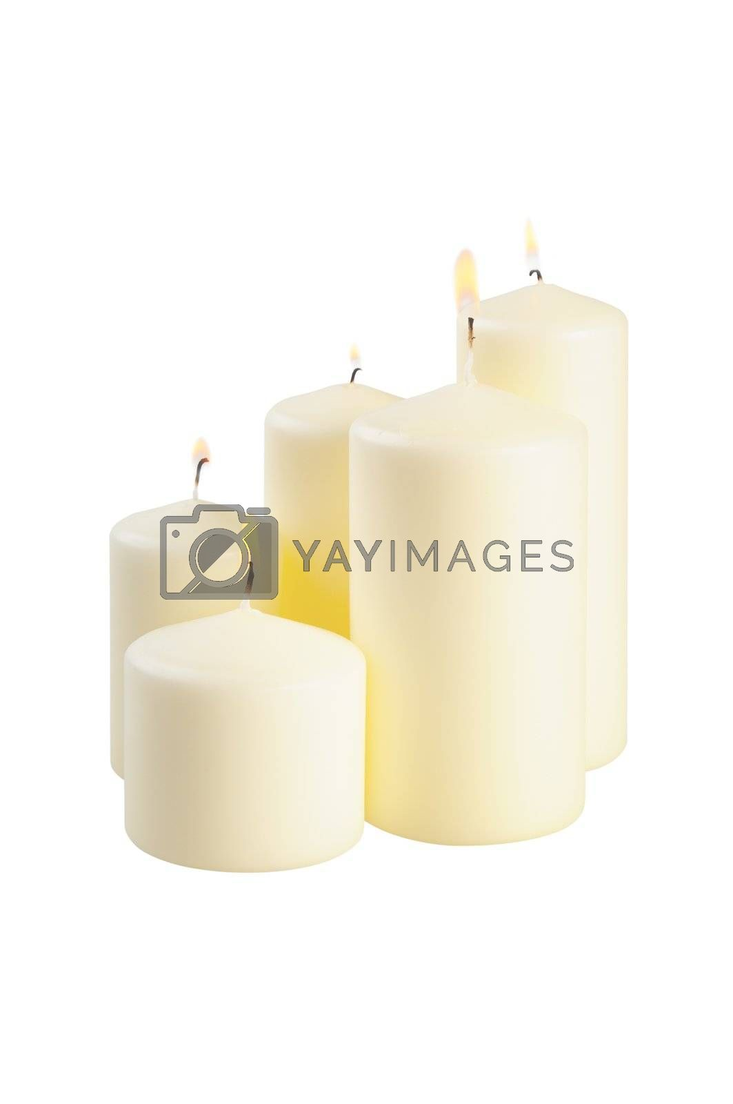 Five large lighted candle. Isolated on white.