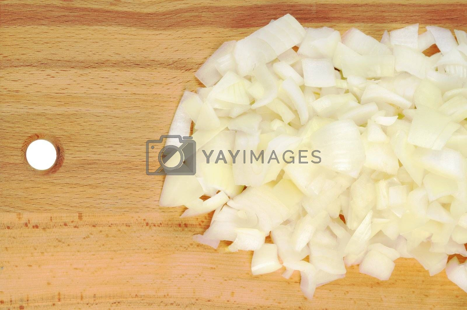Chopped onions on a wooden board. CloseUp.