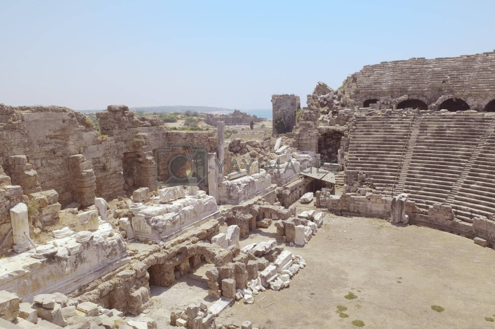 The ruins of the ancient amphitheater. Turkey, Side. Amid the ruins - ancient columns.