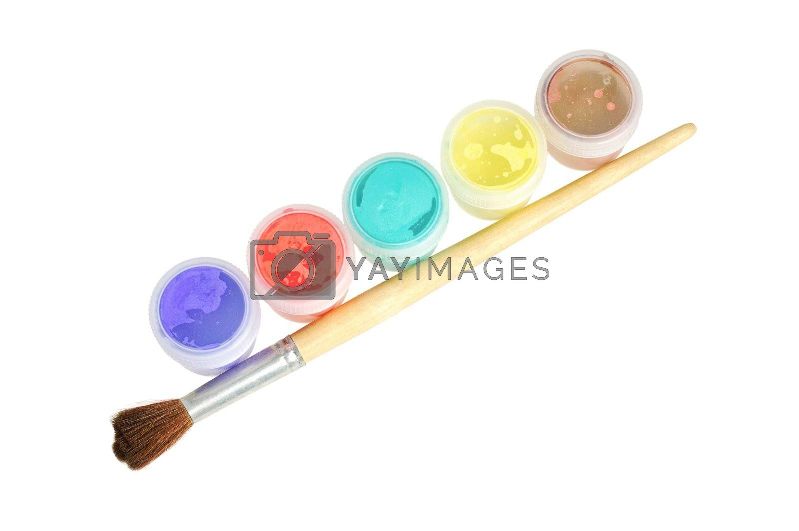 Five cans  of paint and brush.  Isolated  on white.
