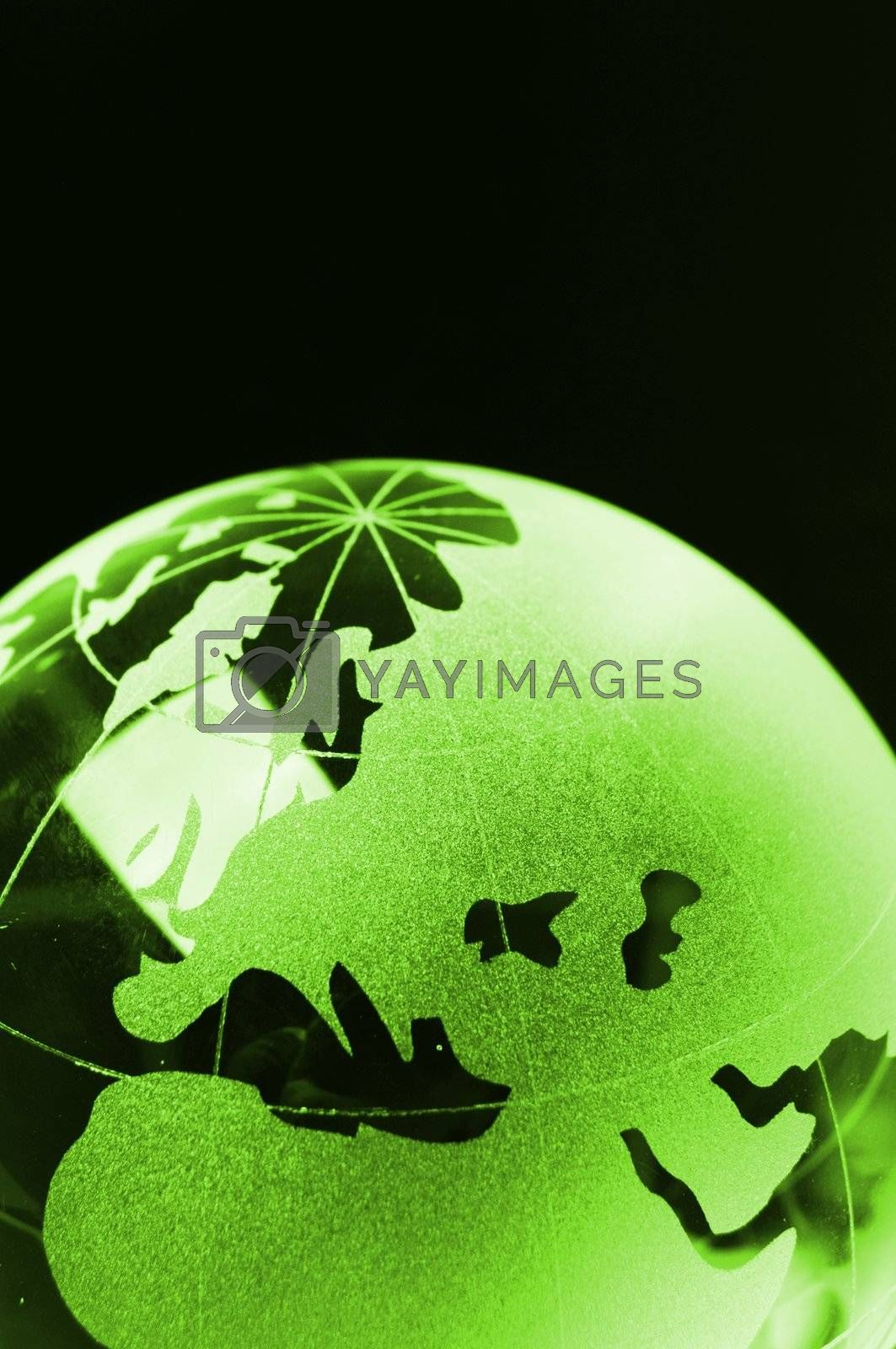 glass globe on black background showing business or environment concept with copyspace