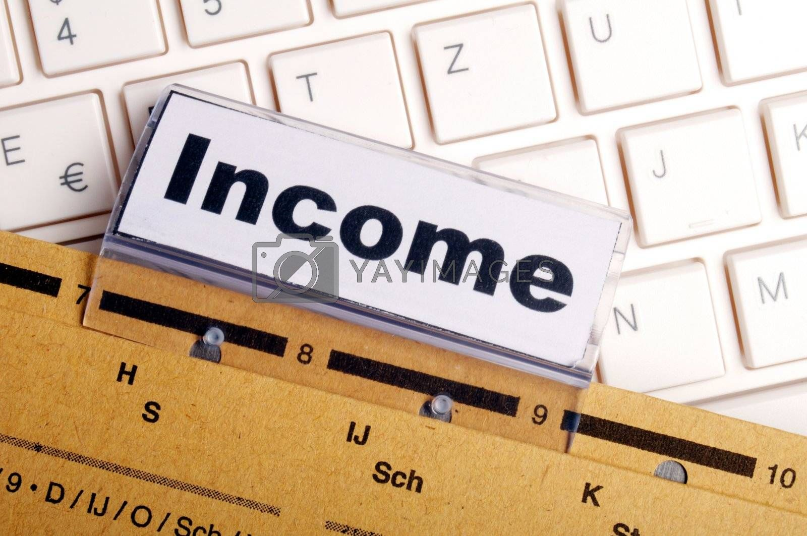 income word on business folder showing finance financial or earnings concept