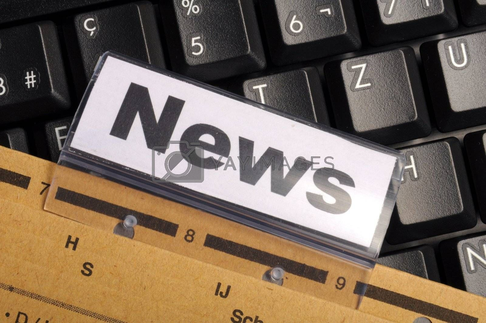 news or newsletter concept with word on folder register in business office