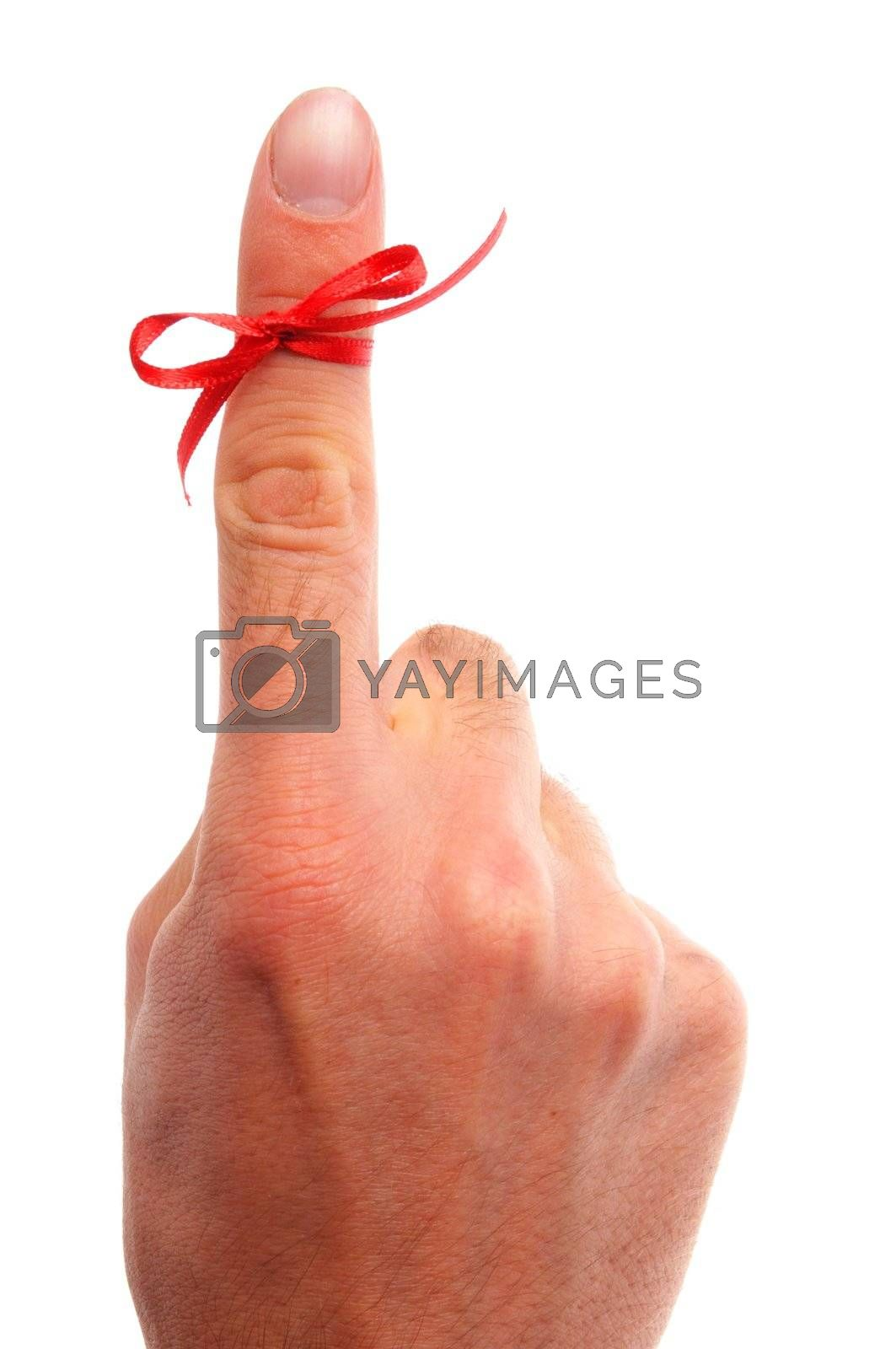 reminder concept with hand and red bow isolated on white background