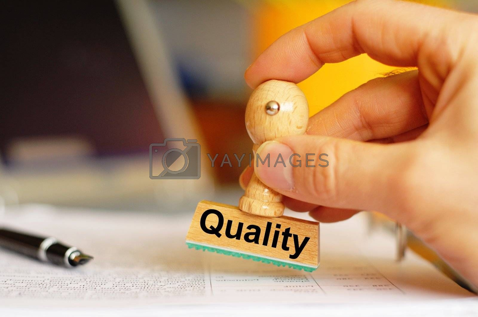 quality concept with stamp in business office and copyspace