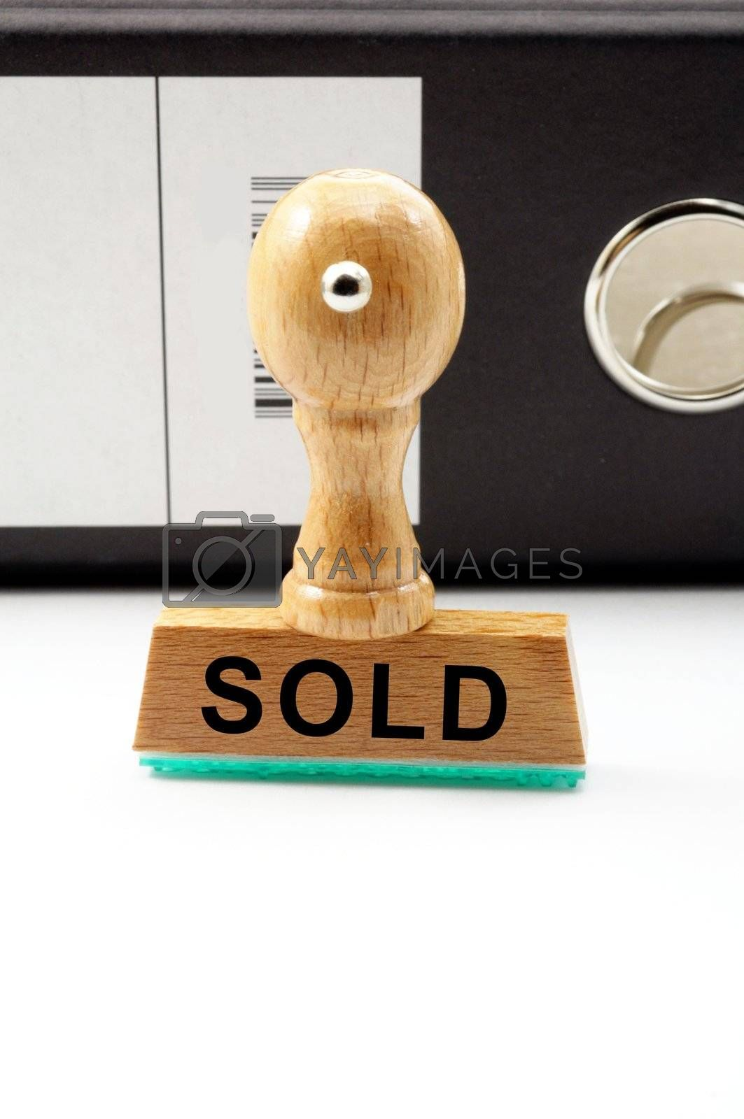 sold concept with stamp in business office showing commerce