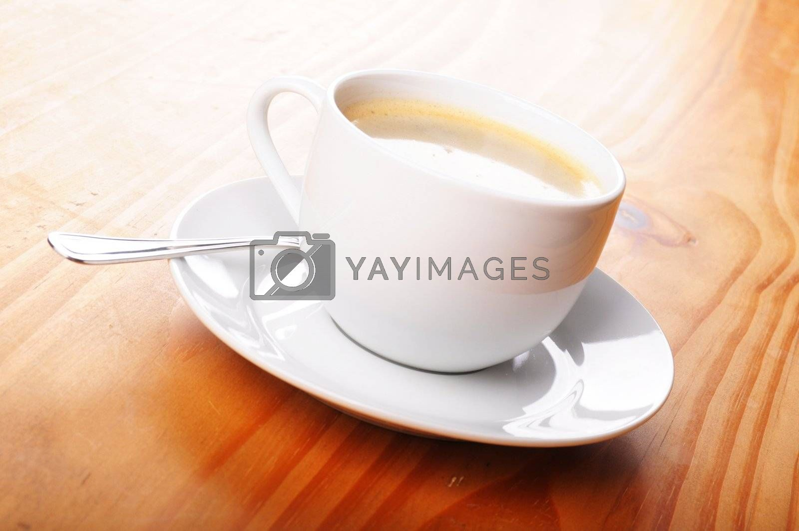 cup of hot coffee with copyspace and beans