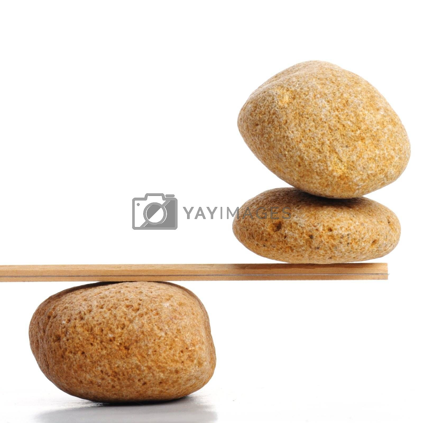 scales with zen stone isolated on white showing balance or spa
