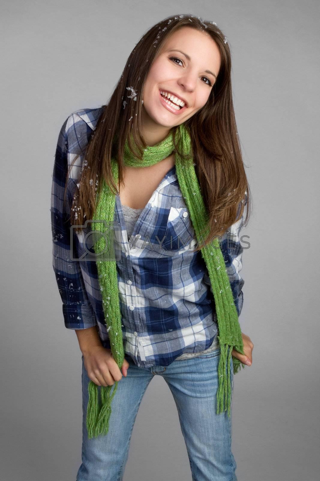 Beautiful teenage winter girl smiling
