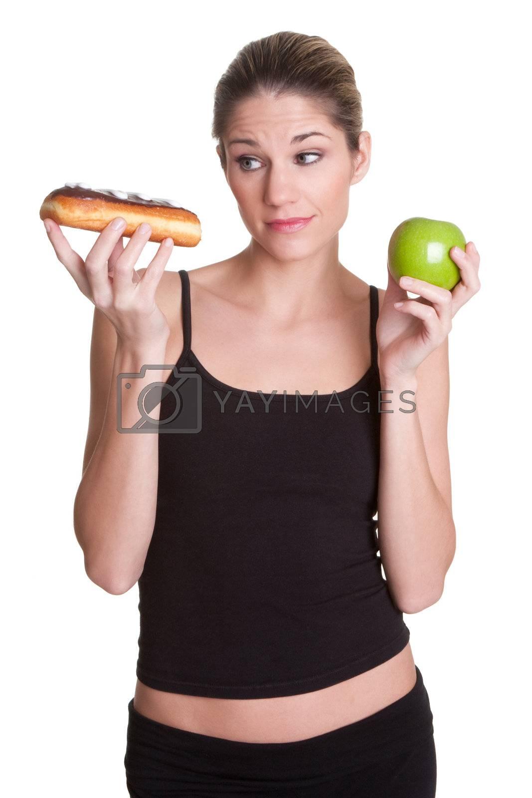 Diet woman holding donut apple