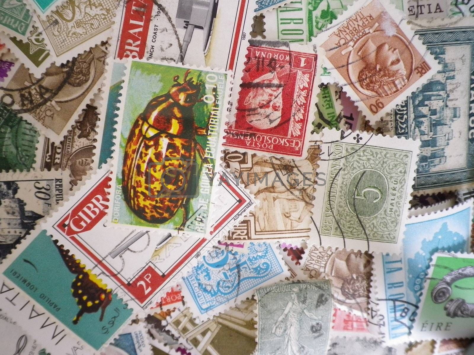 an assortment of old franked postage stamps