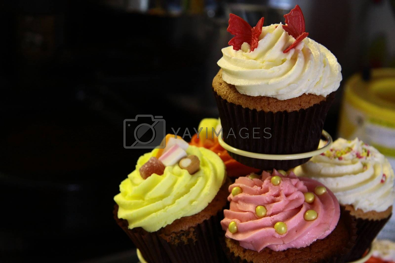 assortment of delicious fancy cupcakes on a cake stand