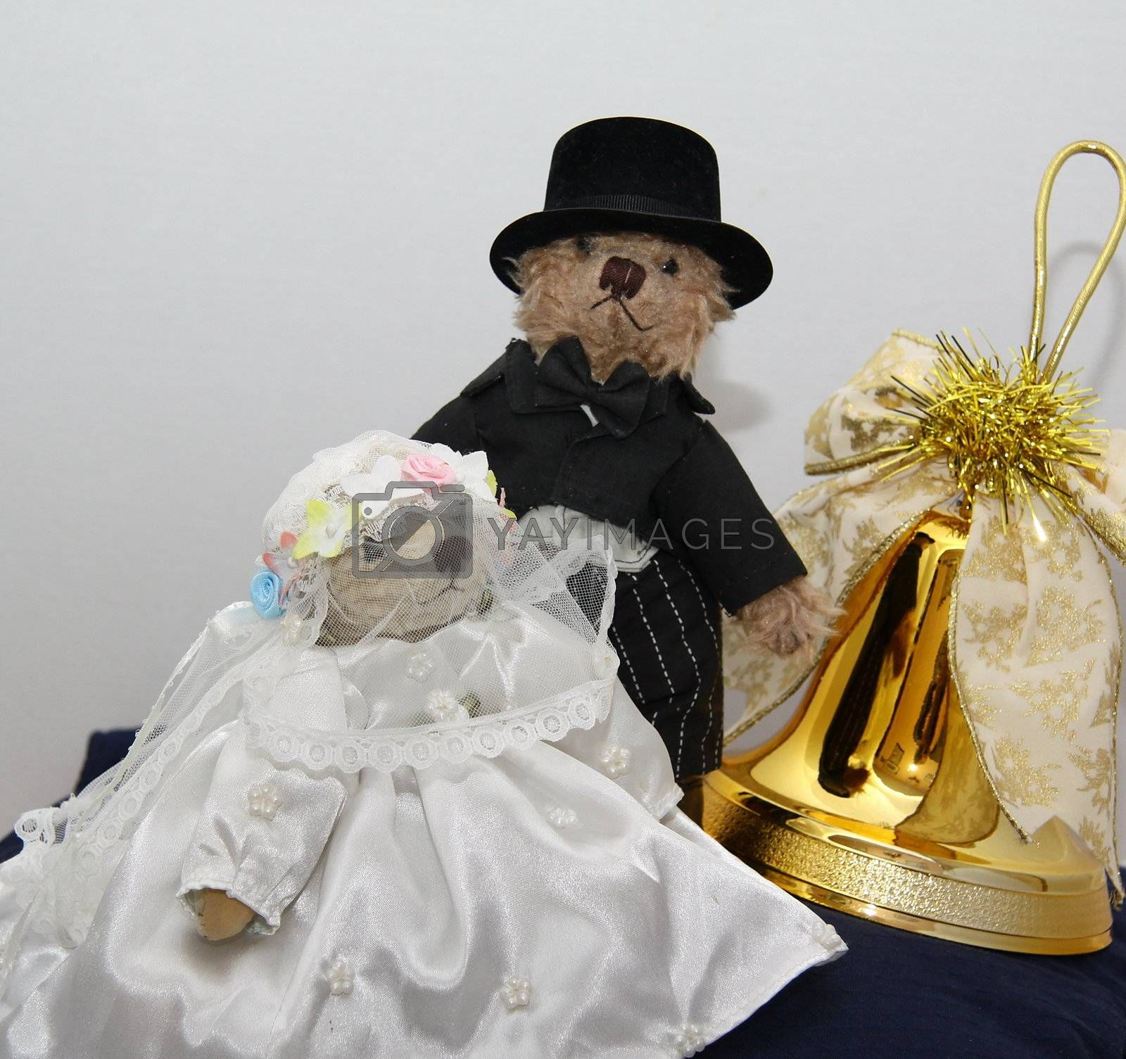 bridal couple of cute teddy bears with a golden bell with the concept of a christmas wedding.