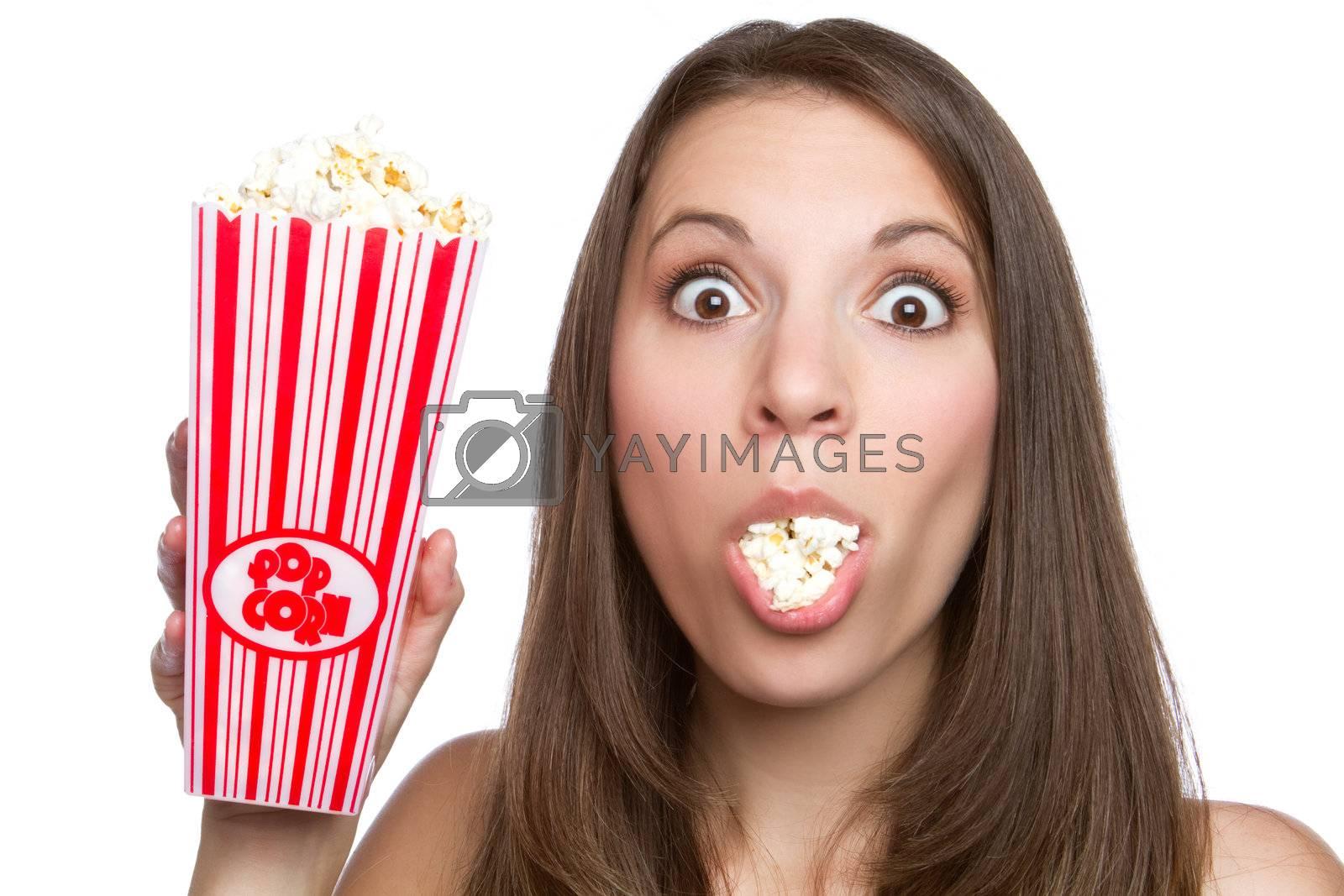 Beautiful young girl eating popcorn