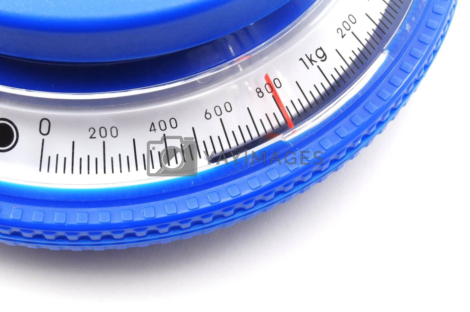 blue kitchen scales or balance showing cooking concept