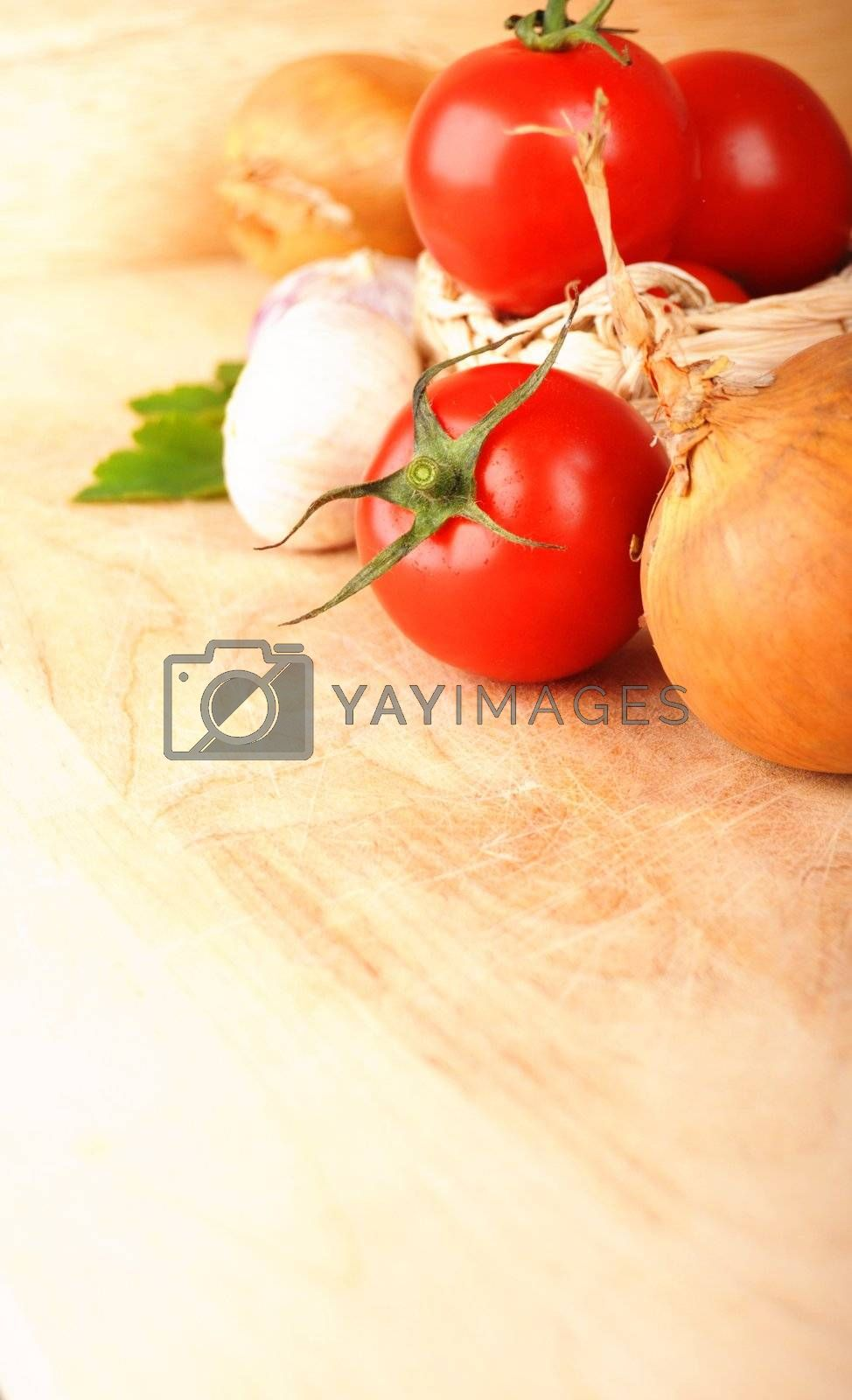 tomatoes garlic and other vegetables in kitchen showing healthy food concept