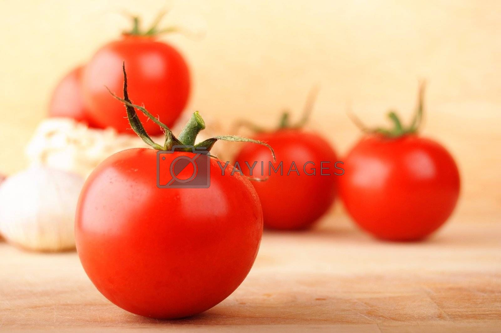 tomatoes and garlic in kitchen on wood with copyspace