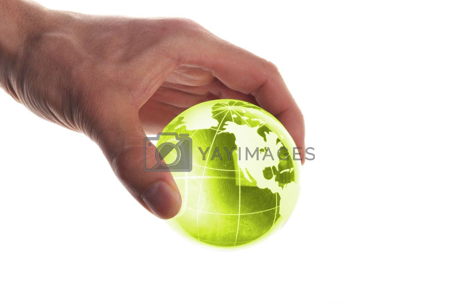 hand holding globe to protect the fragile environment