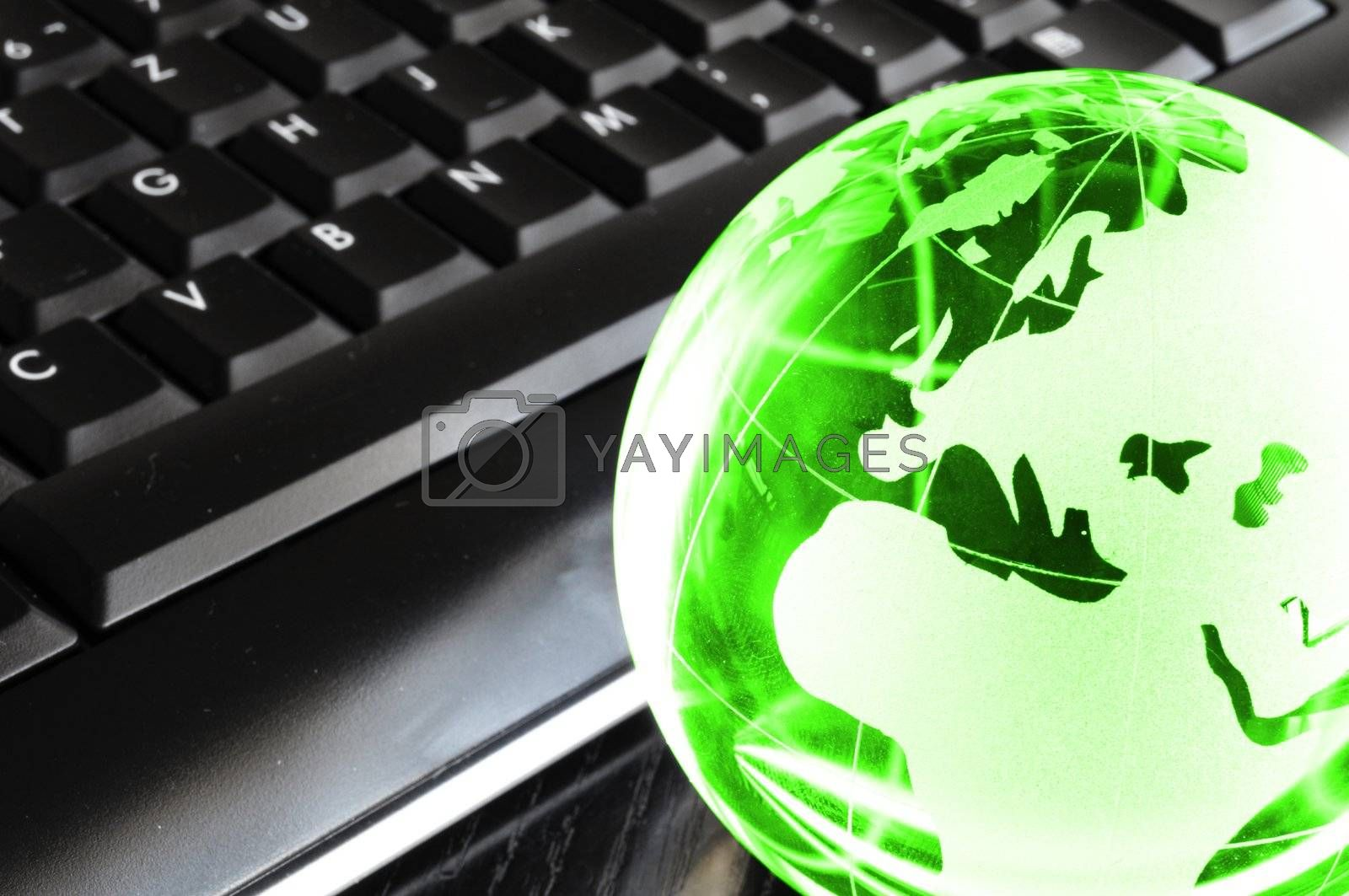 globalisation concept with glass planet on computer keyboard and copyspace