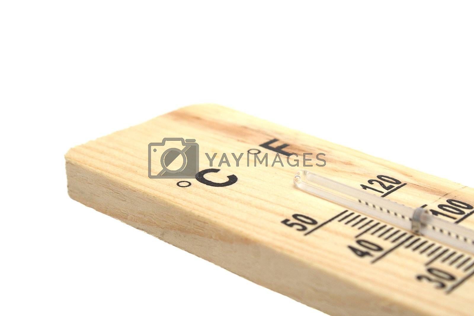 Wooden thermometer with black numbers on white background
