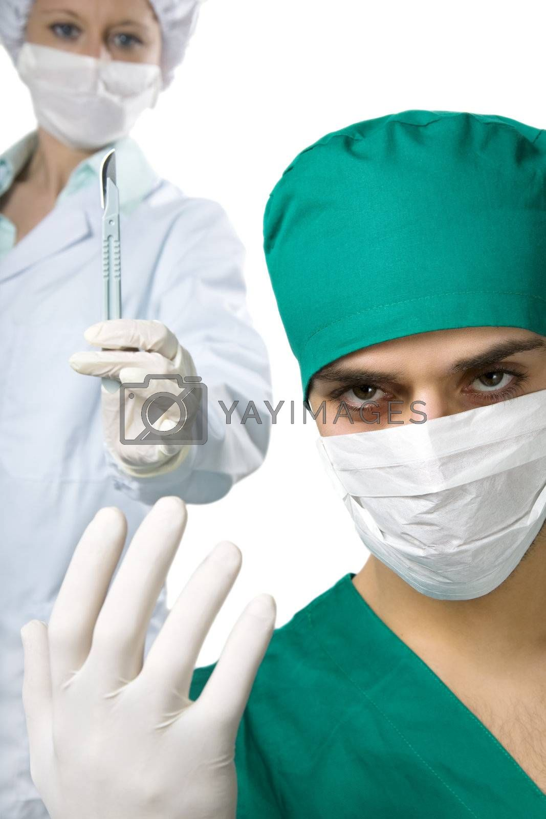 healthcare and medicine: surgeon and his staff during an operation