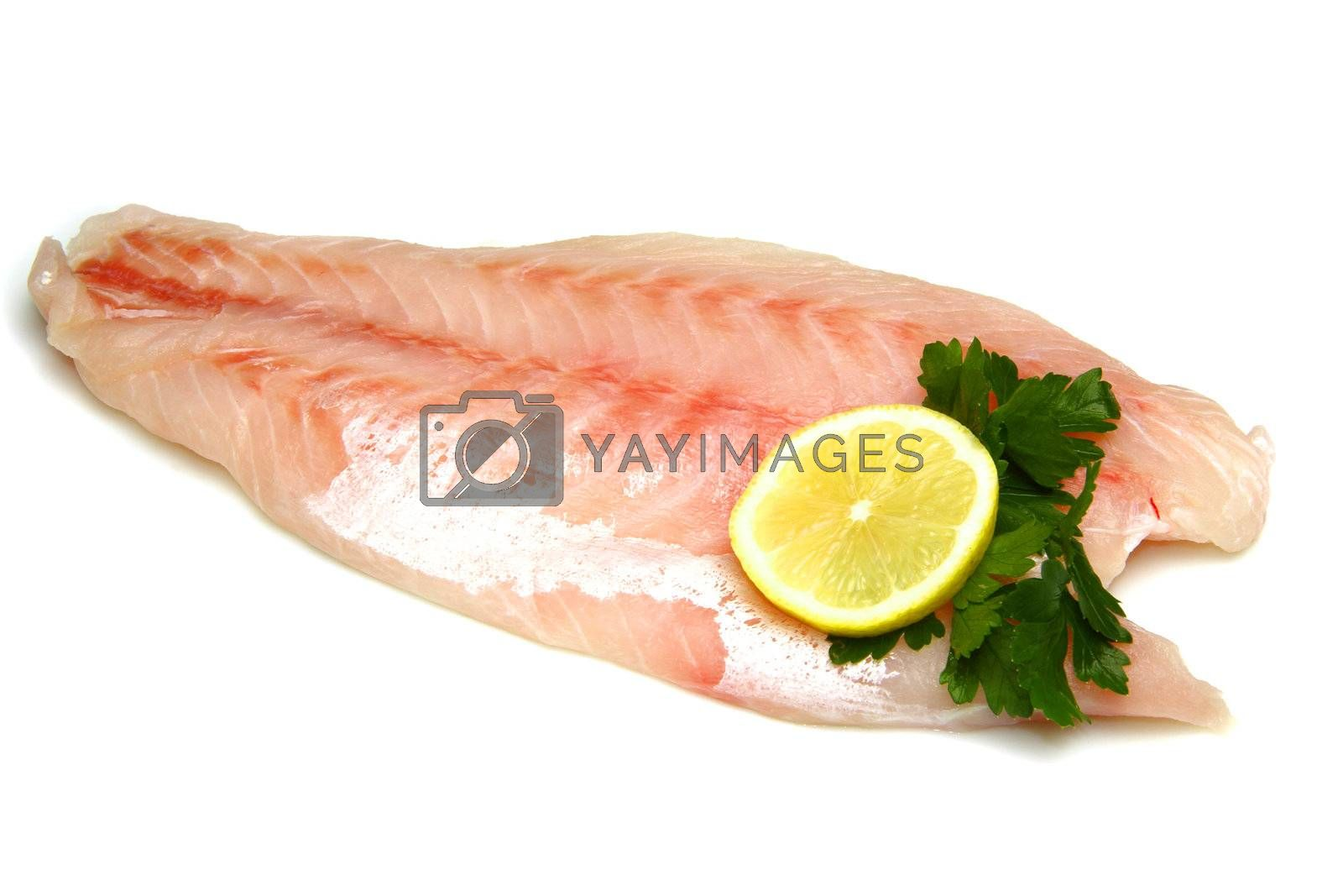 Royalty free image of Fresh crude fish fillet by lsantilli