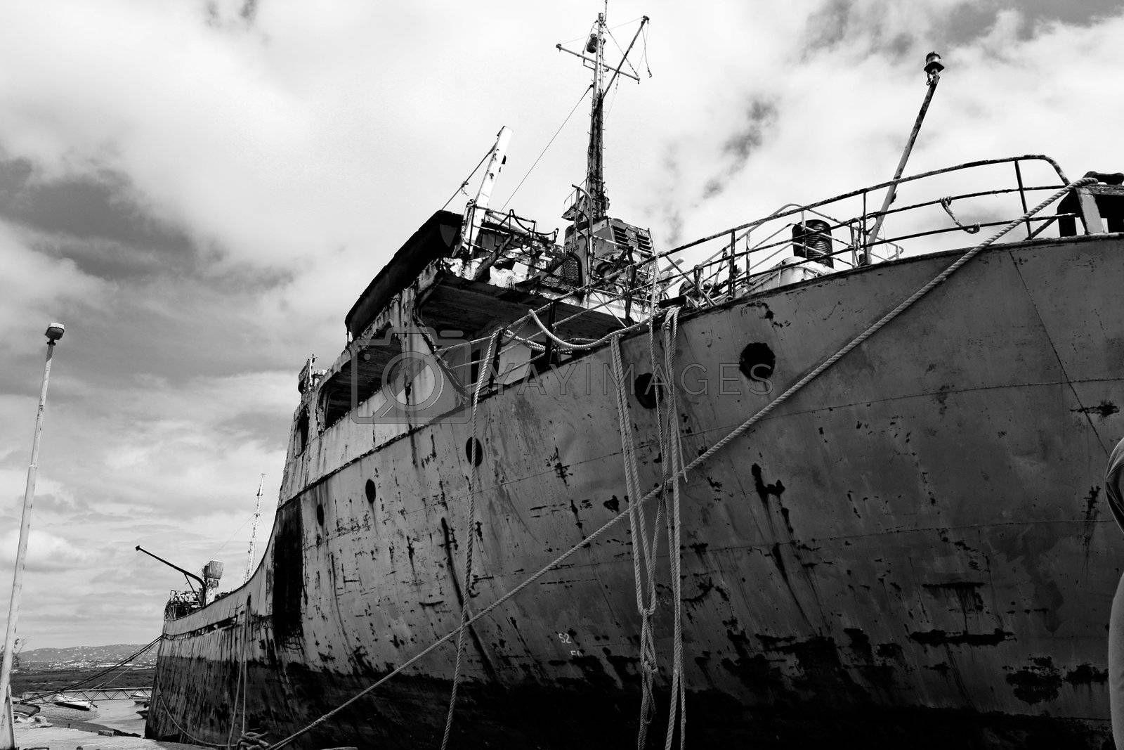 View of an abandoned ship on the docks.