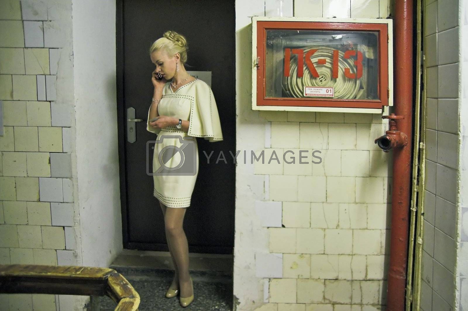 ST PETERSBURG, RUSSIA-APRIL 25, 2008: Girl talking mobile phone while in backstage during art exhibition.