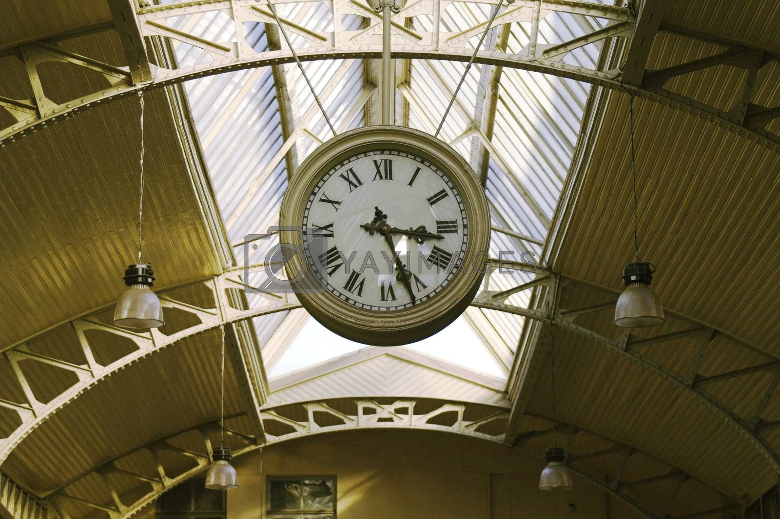 Big hanging public clocks in a railroad station hall, Vitebsk Railroad Station, Saint Petersburg, Russia.