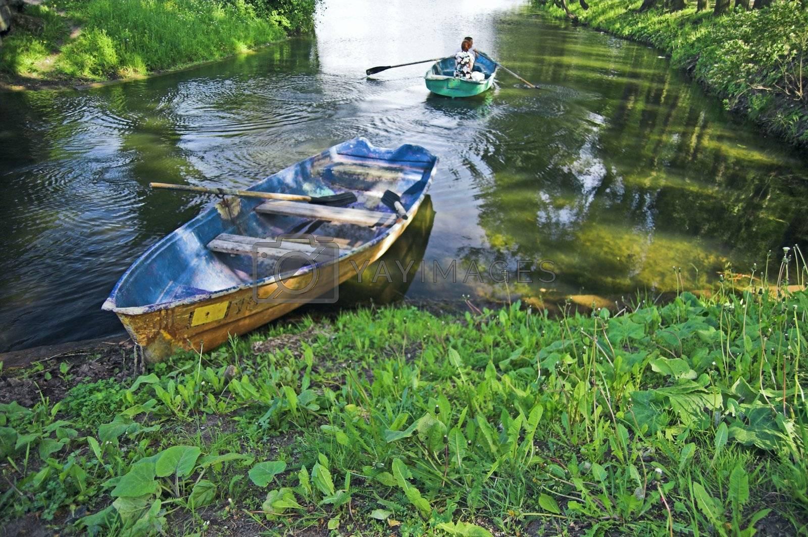 Boat at lake shore in summer park in Saint Petersburg, Russia