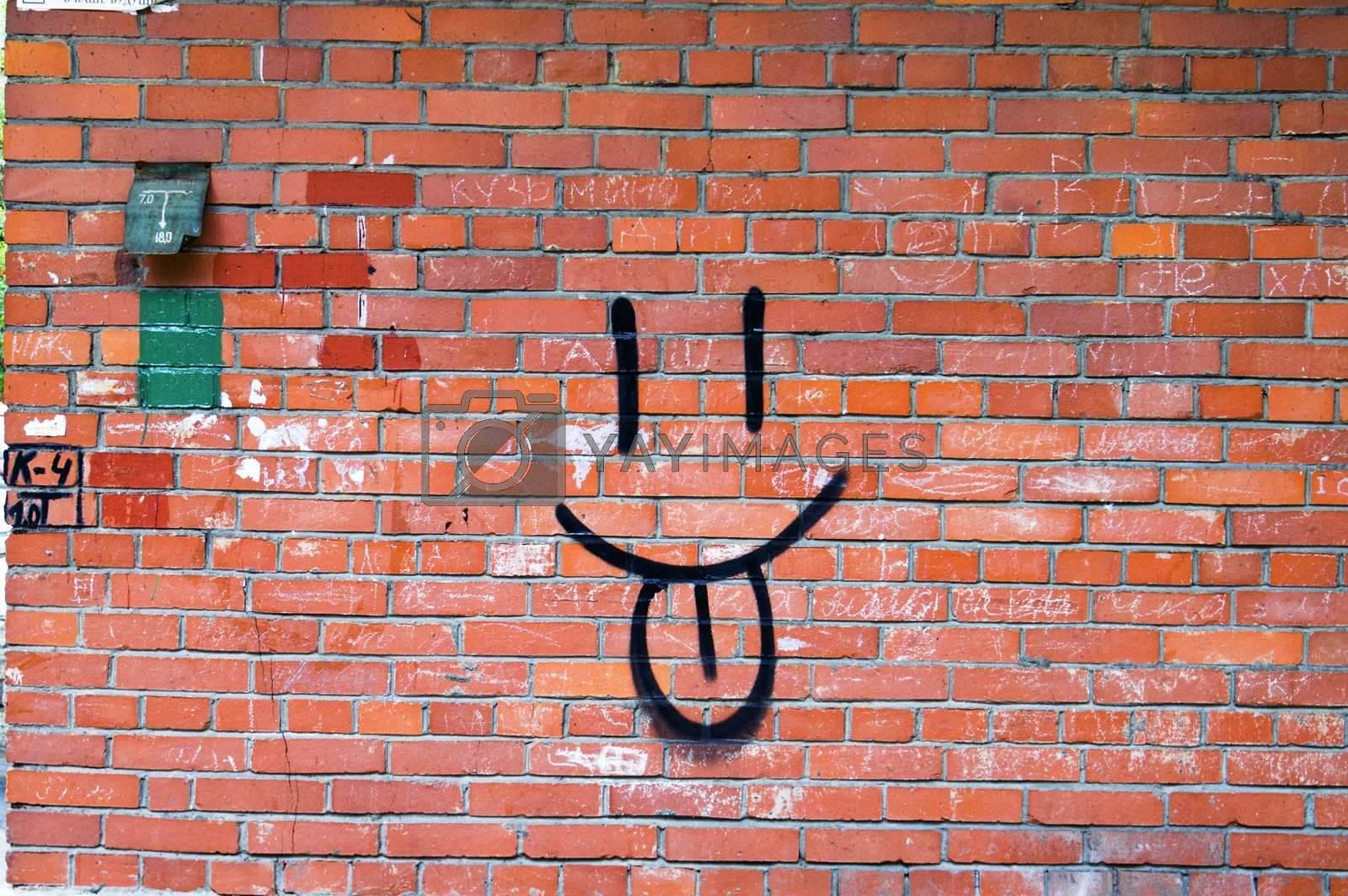 Smile Graffiti on Red Brick Wall.