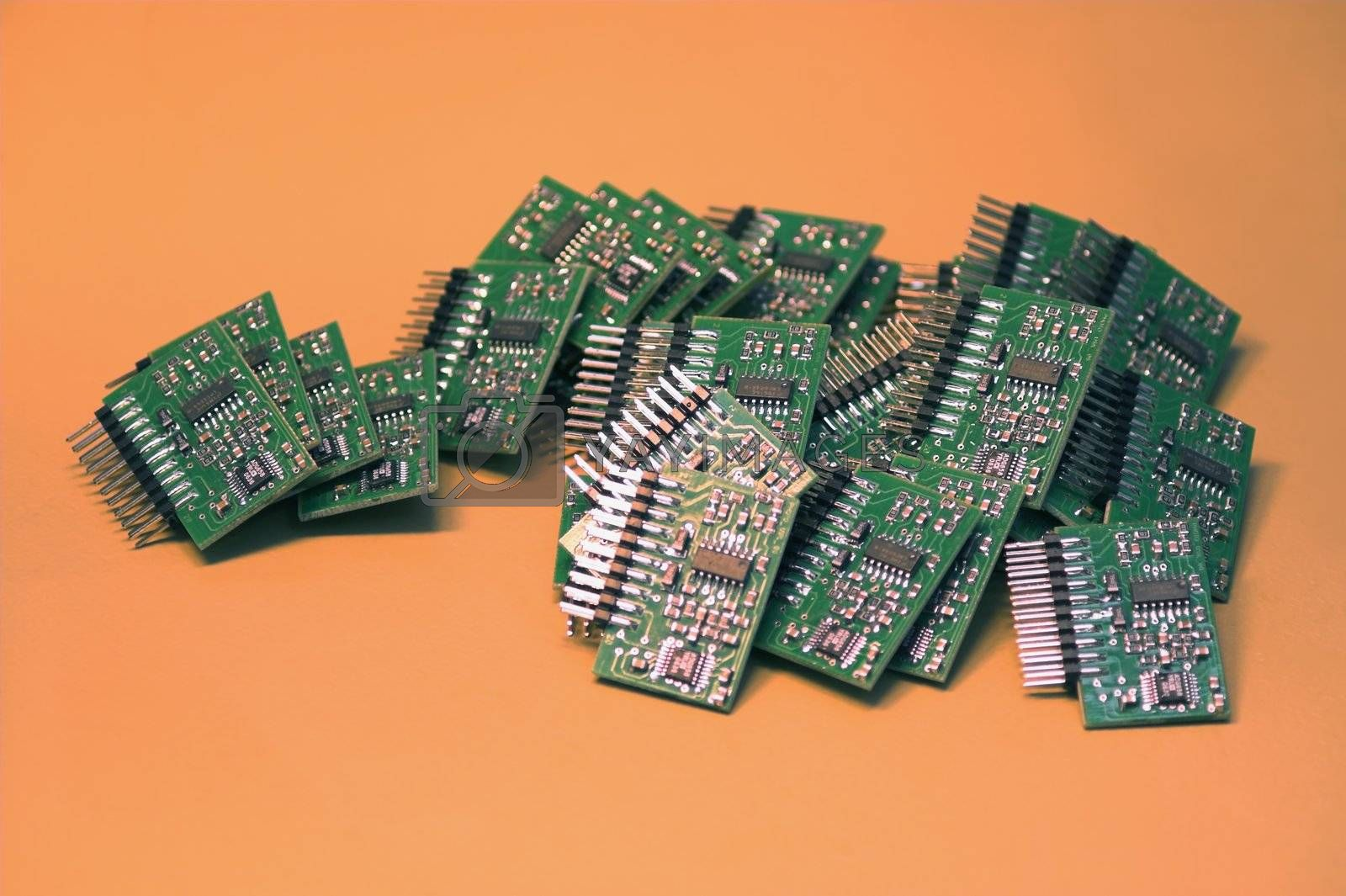 A heap of microchips lying on a table.