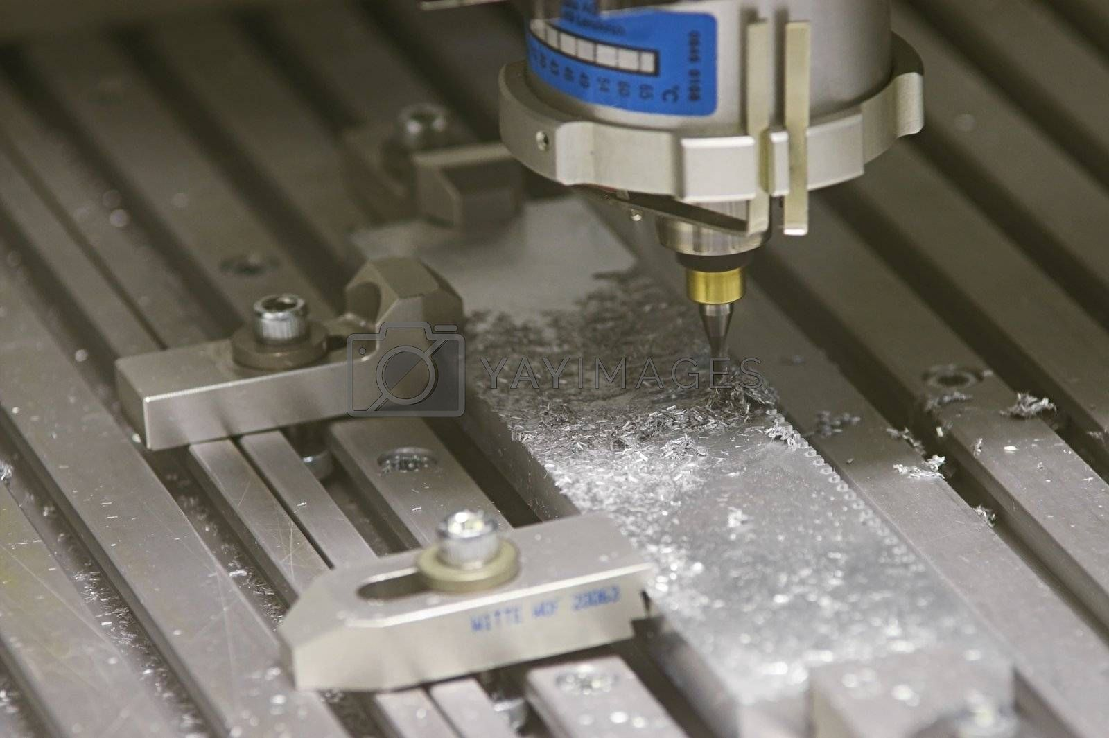 Drilling Machine automatically processing a metallic part.