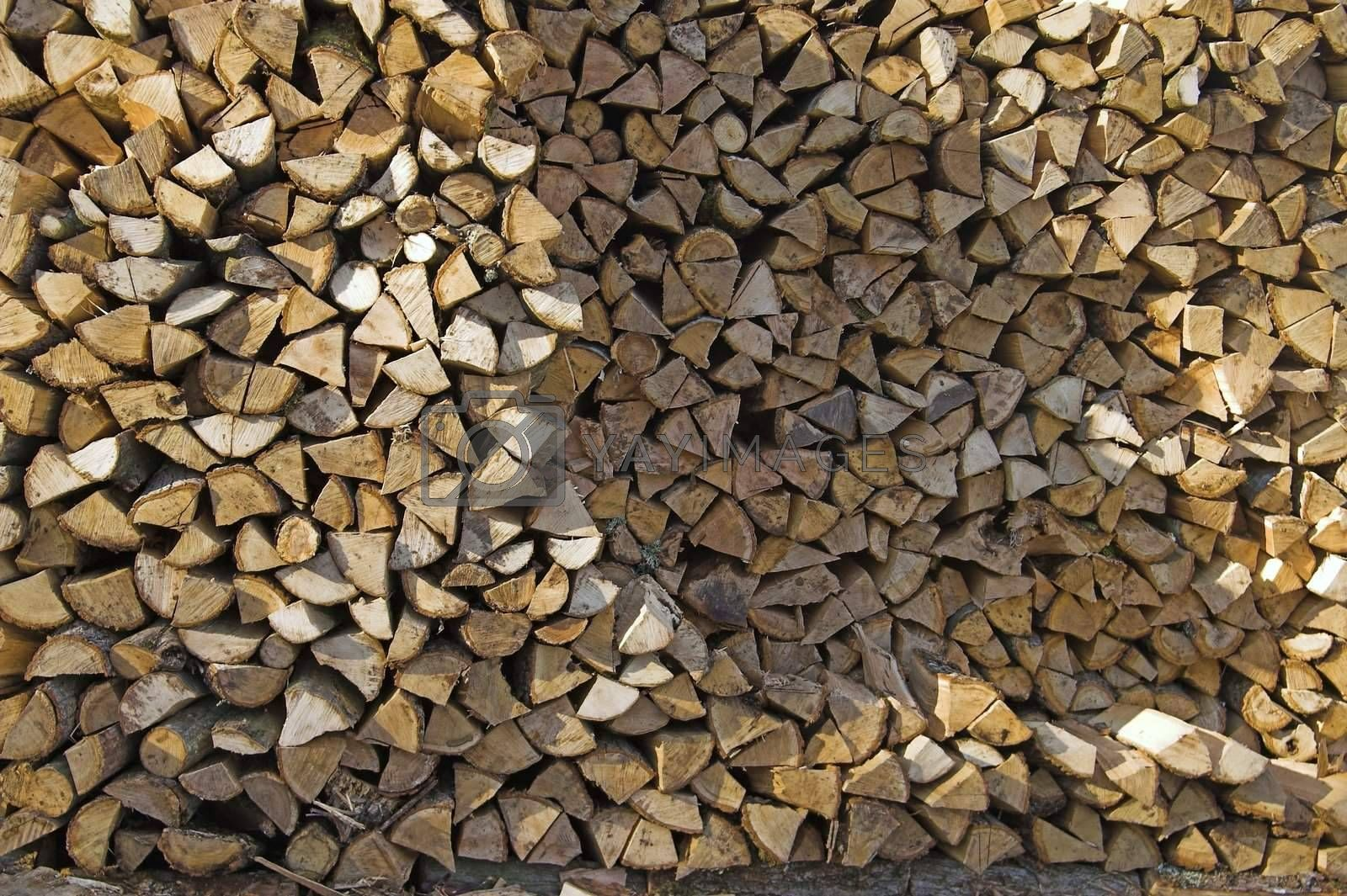Stack of Firewood Piled By House