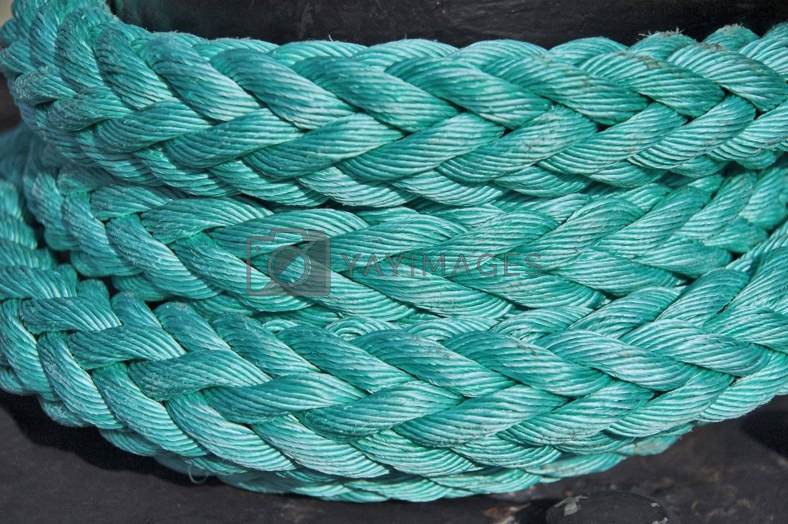 Mooring bollard with nautical rope knotted on it