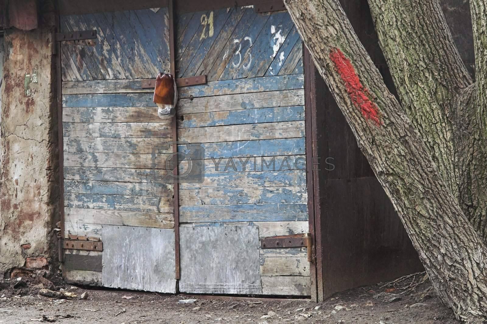 Gates of old garage in back alley