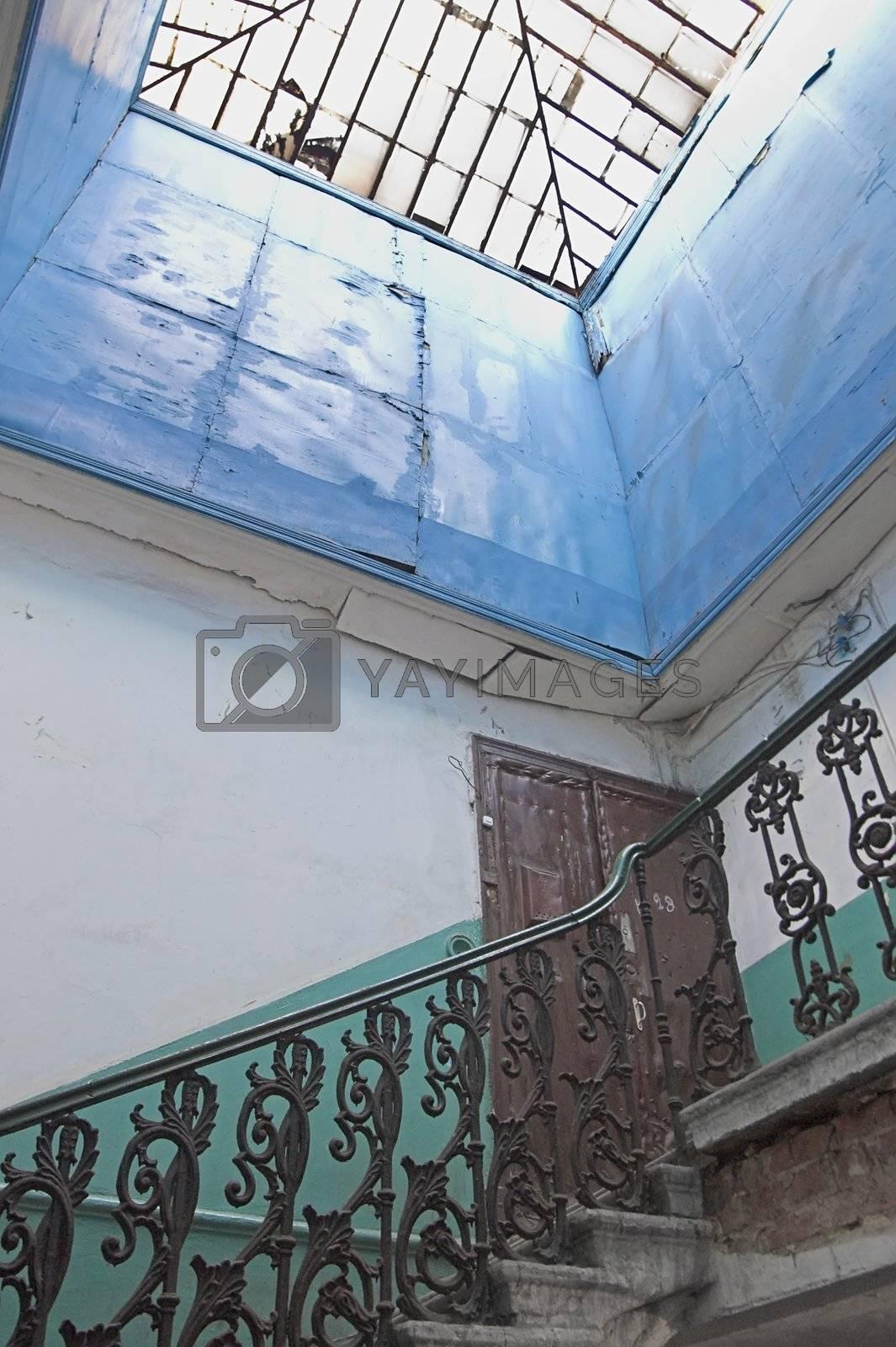 Upper floor in old house with broken glass roof