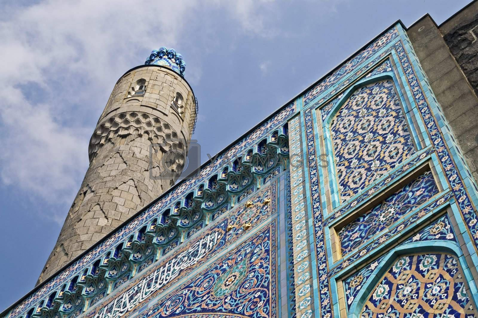 The minaret and the front wall with Arabic mosaics of the ancient mosque in Saint Petersburg, Russia.