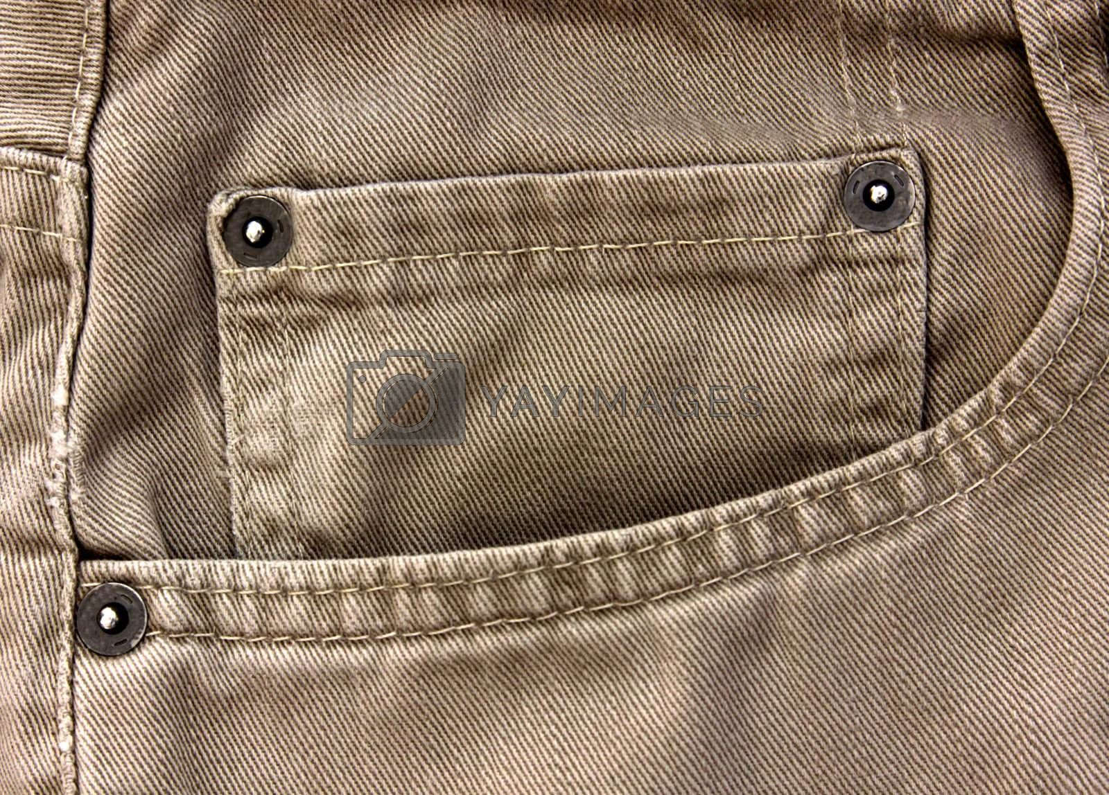 A close up of a beige jean pocket.