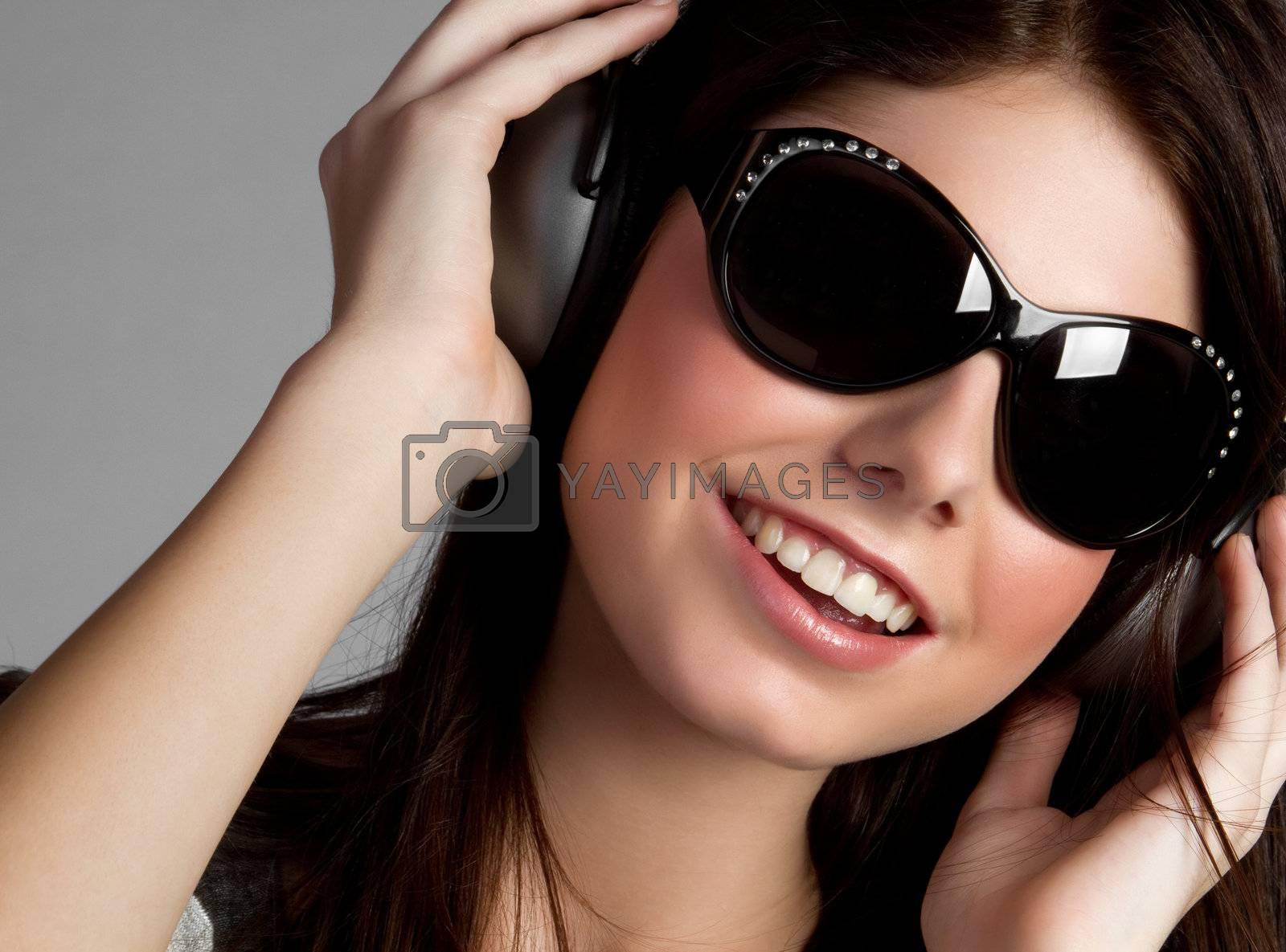Headphones music girl wearing sunglasses