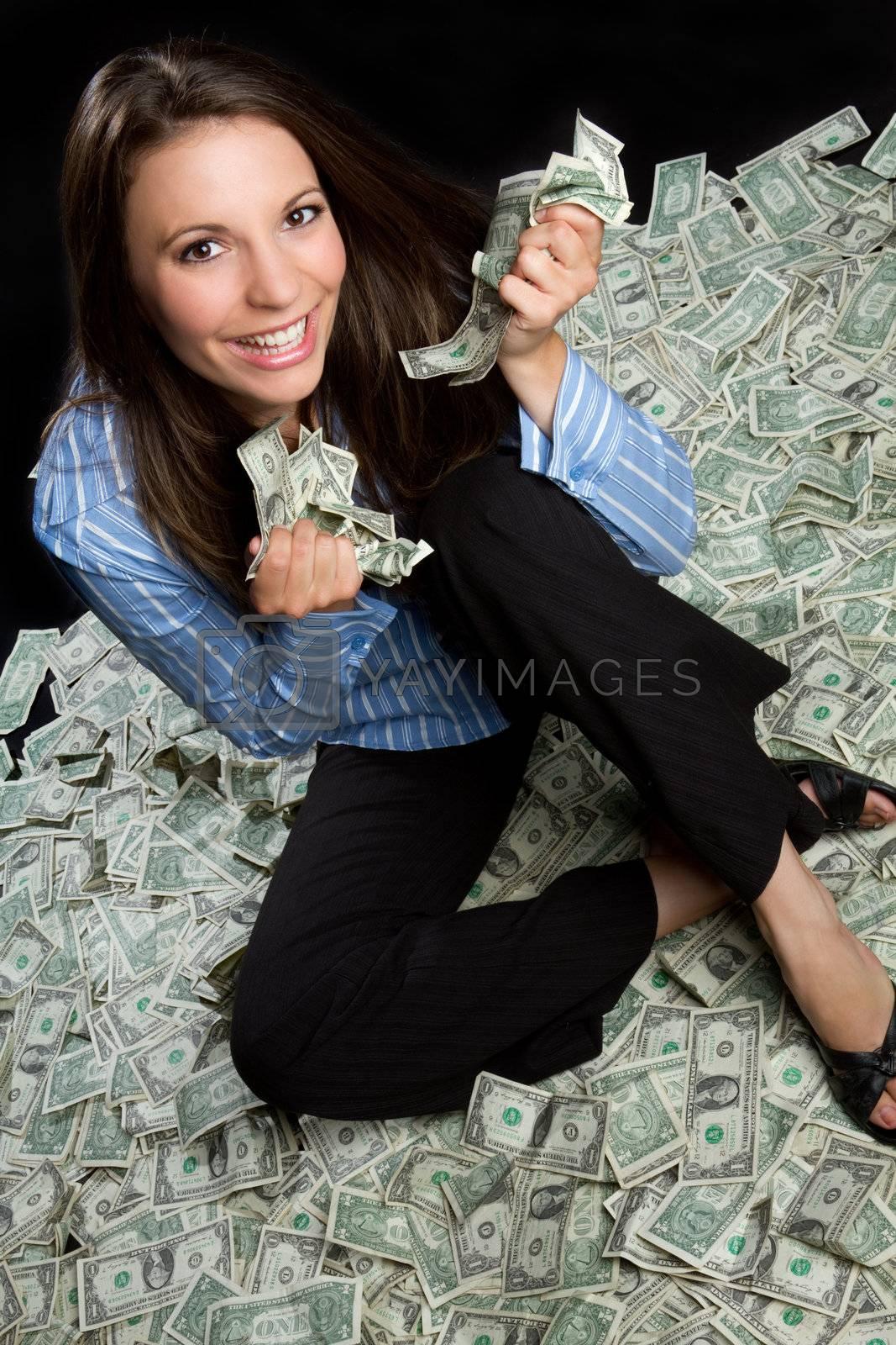 Beautiful smiling woman holding money