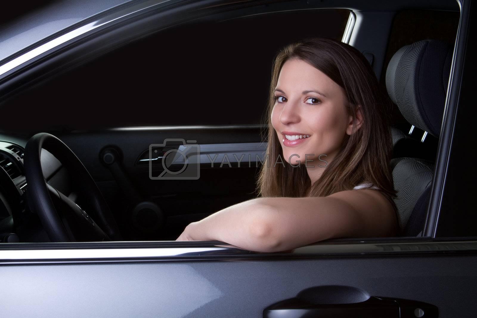 Teen girl sitting in car