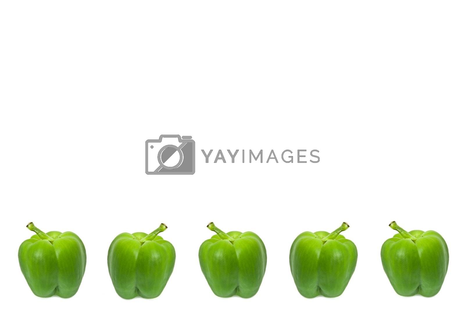 Five small whole green peppers arranged horizontally along the bottom border of the image over white.