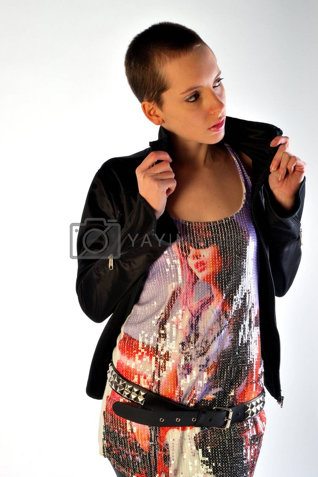 Modern looking young woman in colourful shirt and leather